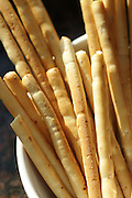 Detail of bread sticks in a serving bowl.