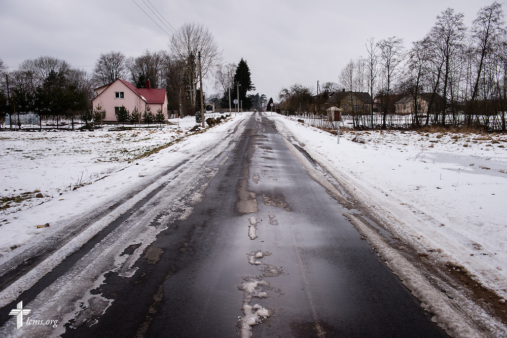 Snow lines the street near the Diaconia daycare center under the Evangelical Lutheran Church in Lithuania on Friday, Feb. 6, 2015, in rural Skirsnemune, Lithuania. LCMS Communications/Erik M. Lunsford
