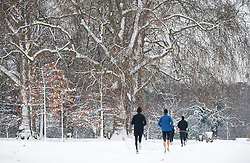 © under license to London News Pictures. 19/12/2010. Joggers wade through a blanket of snow in Hyde Park, London today (19/12/2010). The UK was covered in a blanket of snow over the weekend causing travel chaos. Photo credit should read: London News Pictures.