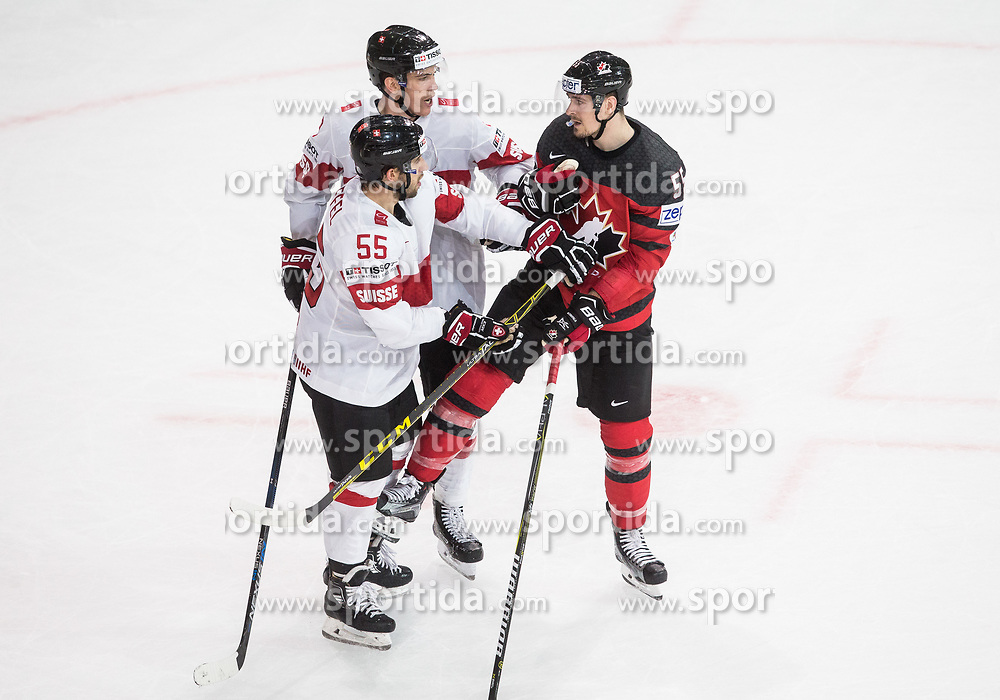 Romain Loeffel of Switzerland and Reto Schappi of Switzerland vs Mark Scheifele of Canada during the 2017 IIHF Men's World Championship group B Ice hockey match between National Teams of Canada and Switzerland, on May 13, 2017 in AccorHotels Arena in Paris, France. Photo by Vid Ponikvar / Sportida