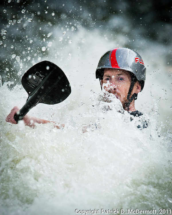 A kayaker competes in the 2011 Potomac Whitewater Festival at Great Fall on the Potomac River in Potomac, Maryland on Saturday, June 25, 2011.