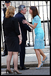 Gordon  Brown is greeted by Samantha Cameron as he arrives with wife Sarah  for lunch with The Queen and Duke of Edinburgh, Prime Minister David Cameron  and other former Prime Minister's at 10 Downing St.,London,  Tuesday, 24th July 2012.  Photo by: Stephen Lock / i-Images