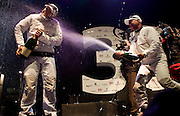14FEB10 The 33rd America's Cup, Valencia, Spain..BMW Oracle Racing win the America's Cup 2010. .Tactician John Kostecki sprays skipper and helmsman James Spithill with champagne in celebration for winning the America's Cup and taking it back to San Fransisco's Golden Gate Yacht Club