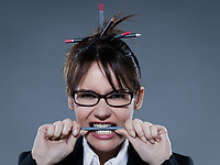 beautiful business woman biting her pencil  on isolated background