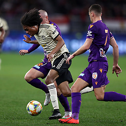 Tahith Chong of Manchester United gets past Neil Kilkenny of Perth Glory
