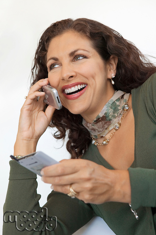 Businesswoman Using Cell Phone and PDA