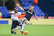 Bolton Wanderers midfielder Darren Pratley fouls Brentford defender Nico Yennaris  during the Sky Bet Championship match between Bolton Wanderers and Brentford at the Macron Stadium, Bolton, England on 30 November 2015. Photo by Simon Davies.