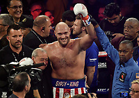 LAS VEGAS, NEVADA - JUNE 15: Tyson Fury(C) poses for the cameras after the fight was stop in the second round at MGM Grand Garden Arena on June 15, 2019 in Las Vegas, Nevada. Tyson Fury took the win by took the win by TKO. MB Media