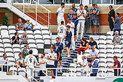 Ollie Robinson of Kent and Grant Stewart of Kent are congratulated by their teammates on the way back to the pavilion after the Specsavers County Champ Div 1 match between Surrey County Cricket Club and Kent County Cricket Club at the Kia Oval, Kennington, United Kingdom on 10 July 2019.