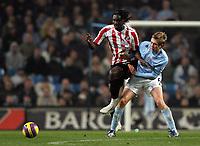 Photo: Paul Thomas/Sportsbeat Images.<br /> Manchester City v Sunderland. The FA Barclays Premiership. 05/11/2007.<br /> <br /> Sunderland's Kenwyne Jones (L) is tackled by Michael Johnson.