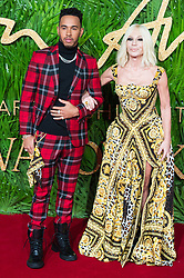 © Licensed to London News Pictures. 04/12/2017. London, UK. LEWIS HAMILTON and DONATELLA VERSACE arrives for The Fashion Awards 2017 held at the Royal Albert Hall. Photo credit: Ray Tang/LNP