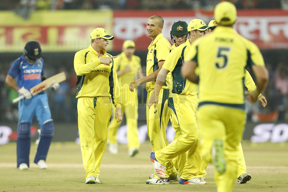 Ashton Agar of Australia celebrates the wicket of Virat Kohli captain of India with team players during the 3rd One Day International between India and Australia held at the Holkar Stadium in Indore on the 24th  September 2017<br /> <br /> Photo by Arjun Singh / BCCI / SPORTZPICS