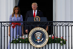 U.S. President Donald Trump and First Lady Melania Trump attend a picnic for military families in Washington, D.C., U.S., on Wednesday, July 4, 2018. Dozens of retired military and national security officers joined the NAACP and the American Medical Association in urging a federal appeals court to uphold a court order blocking Trump's ban on transgender people serving in the military. Photographer: Yuri Gripas/Bloomberg