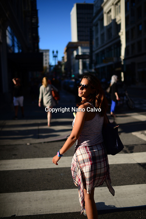 Attractive young woman walking the streets of San Francisco, California.