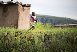 3 March 2017, Thaba Bosiu, Lesotho: A girl carries water to her home in the village of Thaba Bosiu, Lesotho. Parental Consent Obtained. Thaba Bosiu is a sandstone plateau some 24 kilometers east of Lesotho's capital, Maseru. The name means Night Mountain, and surrounding the plateau is a small village and open plains. Thaba Bosiu was once the capital of Lesotho, and the mountain was the stronghold of the Basotho king when the kingdom of Lesotho was formed.