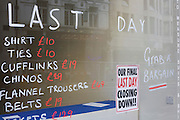 'Last Day' is written on a closed taylors business in London, a victim of the UK recession. Reduced prices and services are listed on the glass with a poster urging customers to grab a bargain. Around a recession-bled Britain, high-street businesses have been going bust in their thousands. Britain has now endured eight recessions since the Second World War. No two recessions are alike, and that applies to the current slowdown also. It has been caused by a shock to the availability of credit, a massive build up of debt. The number of people out of work currently stands at almost two million. Given the rate at which the economy is deteriorating this could easily be above three million. From a continuing piece of work about windows and urban messages, the picture is from the project of closed business windows: 'Bust - the Art of Recession'.