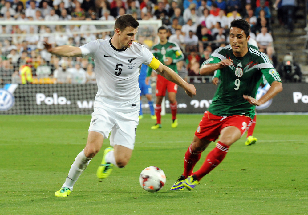 New Zealand's Tommy Smith, left, contests the ball with Mexico's Aldo de Nigris in the World Cup Football qualifier, Westpac Stadium, Wellington, New Zealand, Wednesday, November 20, 2013.Credit:SNPA / Ross Setford