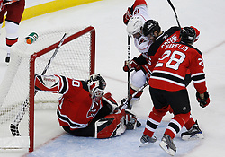 Apr 23, 2009; Newark, NJ, USA; New Jersey Devils goalie Martin Brodeur (30) makes a pad save on Carolina Hurricanes left wing Ryan Bayda (18) while New Jersey Devils defenseman Niclas Havelid (28) and New Jersey Devils defenseman Andy Greene (6) defend during the second period of game five of the eastern conference quarterfinals of the 2009 Stanley Cup playoffs at the Prudential Center.