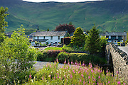 Pub in Lakeland scene near Derwent Water in the Lake District National Park, Cumbria, UK