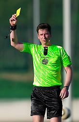 Referee Vojko Gorican with yellow card during football match between NK Triglav Gorenjska and NK Olimpija in 27th Round of Slovenian 1st League PrvaLiga, on April 10, 2011 in Sports park Kranj, Slovenia. (Photo By Vid Ponikvar / Sportida.com)