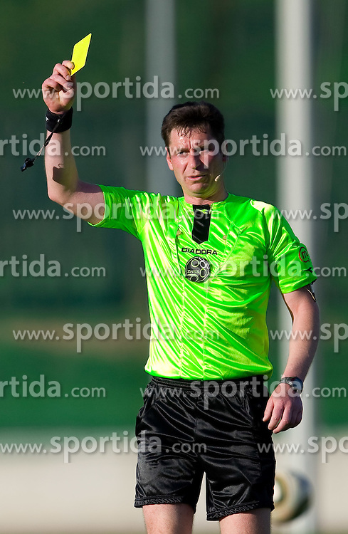 Referee Vojko Gorican with yellow card during football match between NK Triglav Gorenjska and NK Olimpija in 27th Round of Slovenian 1st League PrvaLiga, on April 10, 2011 in Sports park Kranj, Slovenia. (Photo By Vid Ponikvar / Sportida.com)