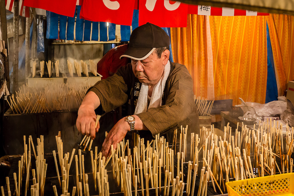 This man was selling strange dark cubes of a gelatinous matter, in a stick. The flavour somehow resembled squid or octopus.