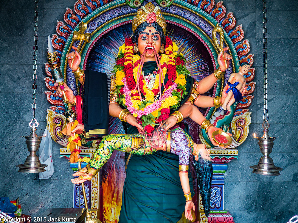 """27 DECEMBER 2015 - SINGAPORE, SINGAPORE: A depiction of the Goddess Kali in Sri Veeramakaliamman Temple in Singapore. Sri Veeramakaliamman Temple in the """"Little India"""" section of Singapore, was one of the first Hindu temples in Singapore and is dedicated to the Goddess Kali, the Hindu """"Destroyer of Evil.""""  It's on Serangoon Road, which at one time was the center of Singapore's Indian community and served Indian immigrants who worked in the cattle trade that was based around Serangoon Road in the 19th century. Now the temple is a popular tourist site.     PHOTO BY JACK KURTZ"""