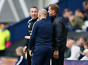 Neil Harris Manager of Millwall, Alex Neil Manager of Preston North End and Fourth Official Ricky Wootton during the EFL Sky Bet Championship match between Preston North End and Millwall at Deepdale, Preston, England on 23 September 2017. Photo by Paul Thompson.
