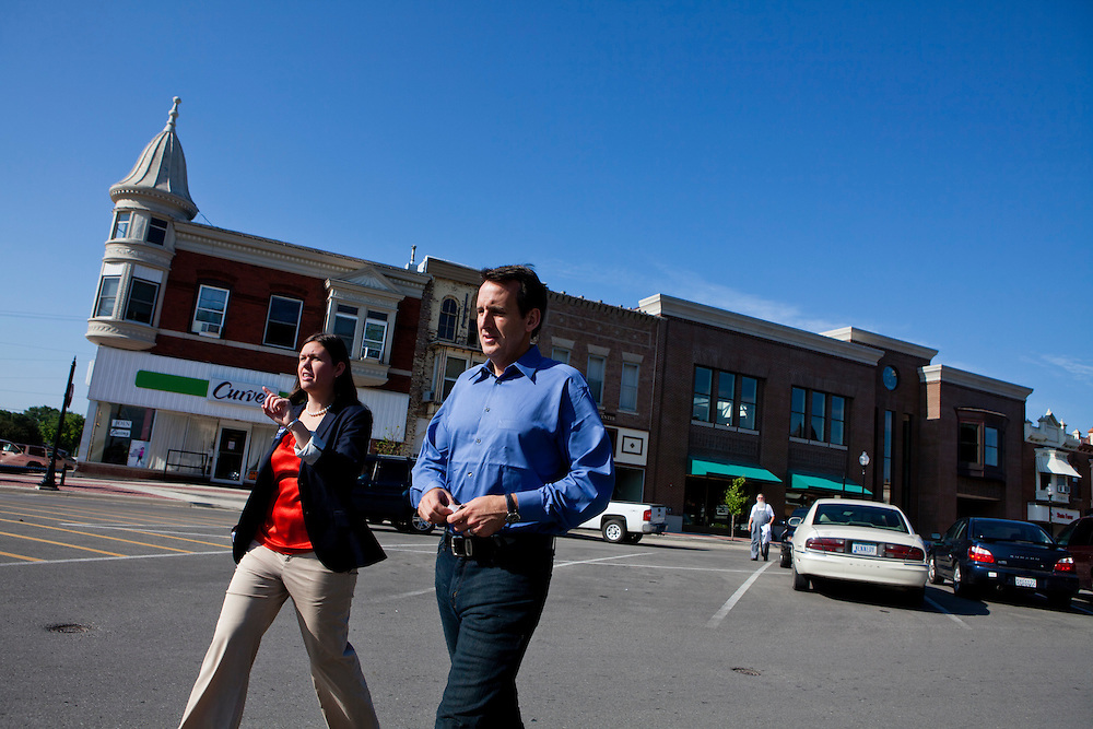 Sarah Huckabee Sanders, left, and Republican presidential hopeful Tim Pawlenty leave a campaign stop on Tuesday, July 26, 2011 in Washington, IA.