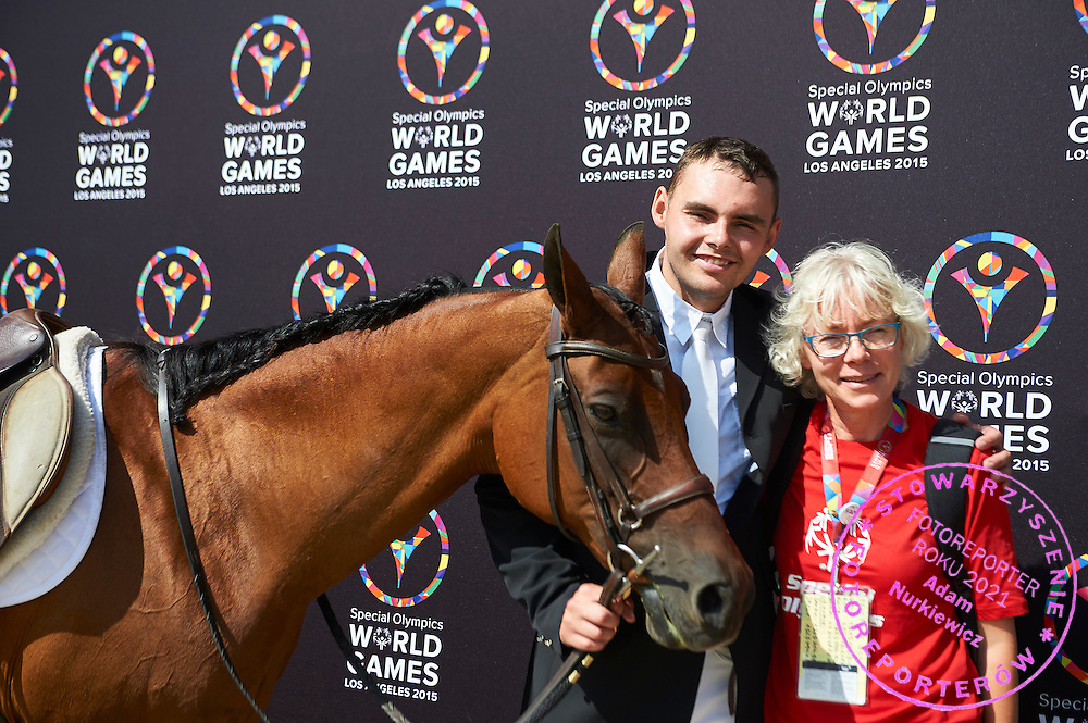 SO Poland athlete Pawel Bernat with horse called Sinatra and his trainer coach pose to picture while equestrian competition during eighth day of the Special Olympics World Games Los Angeles 2015 on August 1, 2015 at Equestrian Centre Riverside Drive Burbank in Los Angeles, USA.<br /> USA, Los Angeles, August 1, 2015<br /> <br /> Picture also available in RAW (NEF) or TIFF format on special request.<br /> <br /> For editorial use only. Any commercial or promotional use requires permission.<br /> <br /> Adam Nurkiewicz declares that he has no rights to the image of people at the photographs of his authorship.<br /> <br /> Mandatory credit:<br /> Photo by &copy; Adam Nurkiewicz / Mediasport