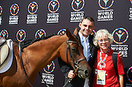 SO Poland athlete Pawel Bernat with horse called Sinatra and his trainer coach pose to picture while equestrian competition during eighth day of the Special Olympics World Games Los Angeles 2015 on August 1, 2015 at Equestrian Centre Riverside Drive Burbank in Los Angeles, USA.<br /> USA, Los Angeles, August 1, 2015<br /> <br /> Picture also available in RAW (NEF) or TIFF format on special request.<br /> <br /> For editorial use only. Any commercial or promotional use requires permission.<br /> <br /> Adam Nurkiewicz declares that he has no rights to the image of people at the photographs of his authorship.<br /> <br /> Mandatory credit:<br /> Photo by © Adam Nurkiewicz / Mediasport