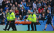 Brighton defender full back Gaetan Bong is injured and stretchered off during the Sky Bet Championship match between Brighton and Hove Albion and Preston North End at the American Express Community Stadium, Brighton and Hove, England on 24 October 2015. Photo by Bennett Dean.