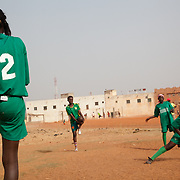 "Girls of Les Amazones of Bakodjikoronì (Bamako) warming before second match of a national league, in district of Bakodjikoronì, that means ""across the river"""