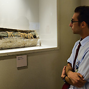 "VENICE, ITALY - SEPTEMBER 30:  A member of staff admires child mummy during the press preview of the Exhibition ""Venice and Egypt""at Palazzo Ducale on September 30, 2011 in Venice, Italy. ""Venice and Egypt"" is an exhibition on the relationship and the ties between Venice and Egypt over almost two thousand years, from ancient times up to the opening of the Suez Canal."