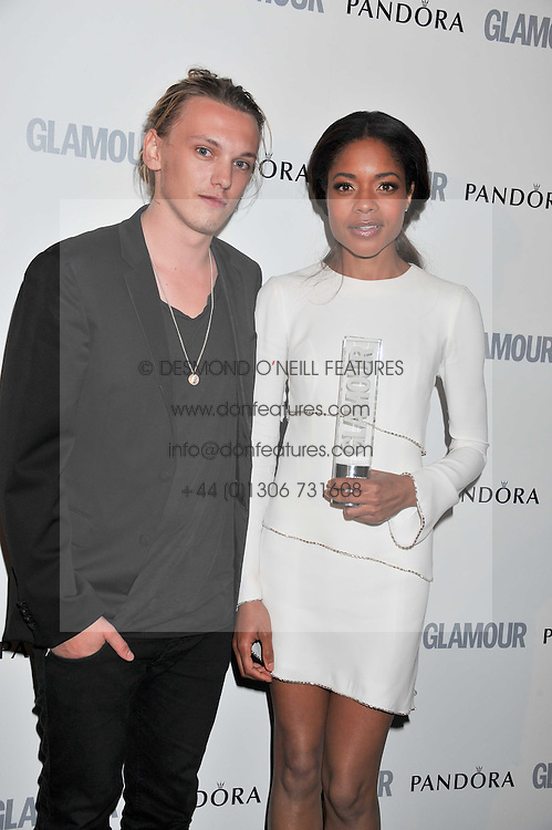 JAMIE CAMPBELL BOWER and NAOMIE HARRIS at the Glamour Women of The Year Awards 2011 held in Berkeley Square, London W1 on 7th June 2011.