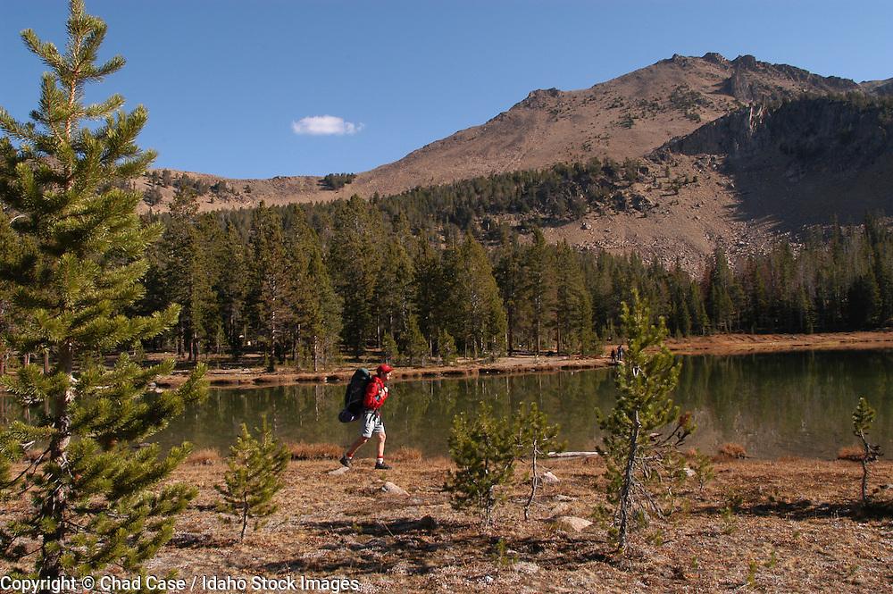 Idaho. White Cloud Mountains. Backpacker at 4th of July Lake. MR