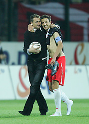 WARSAW, POLAND - WEDNESDAY, SEPTEMBER 7th, 2005: Poland's injured goalkeeper, Jerzy Dudek, celebrates with captain Jacek Bak after his side qualified for the World Cup as they beat Wales 1-0 during the World Cup Group Six Qualifying match at the Legia Stadium. (Pic by David Rawcliffe/Propaganda)