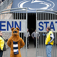 The Penn State Nittany Lion mascot stands by the gate before the team takes the field for the start of the annual Blue/White game on April 20, 2013 at Beaver Stadium in University Park, PA.
