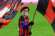 An AFC Bournemouth flag bearer with his face painted on the pitch ahead of the The FA Cup match between Bournemouth and Luton Town at the Vitality Stadium, Bournemouth, England on 4 January 2020.
