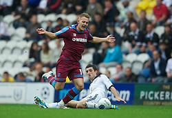 PRESTON, ENGLAND - Saturday, September 24, 2011: Tranmere Rovers' Adam McGurk is brought down by Preston North End's Conor McLaughlin  during the Football League One match at Deepdale. (Pic by Dave Kendall/Propaganda)