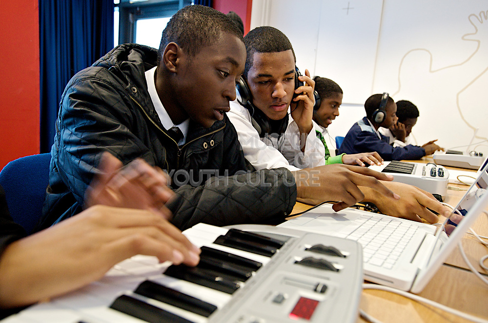 Urban Development. Young people training with computers and music equipment