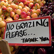 "Fresh produce and warning signs, ""No Grazing Please ..."", Pike Place Market, Seattle, Washington"