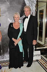 DAME JUDI DENCH and DAVID MILLS at the David Shepherd Wildlife Foundation 30th anniversary Wildlife Ball at The Dorchester, Park Lane, London on 10th October 2014.
