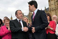 Newly Elected MP for Wythenshawe and Sale East Mike Kane MP shakes hands with Labour leader Ed Miliband outside of The House of Commons on College Green, London, UK.<br /> Monday, 24th February 2014. Picture by Ben Stevens / i-Images