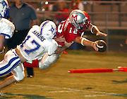 Despite Walton's # 17 Ryan Harkins' efforts Milton's # 12 Brandon Henderson dives in to the end zone for a first quarter touchdown.
