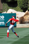 ANAHEIM, CA - APRIL  23:  Peter Bourjos #25 of the Los Angeles Angels of Anaheim plays catch before the game between the Boston Red Sox and the Los Angeles Angels of Anaheim on Saturday, April 23, 2011 at Angel Stadium in Anaheim, California. The Red Sox won the game in a 5-0 shutout. (Photo by Paul Spinelli/MLB Photos via Getty Images) *** Local Caption *** Peter Bourjos