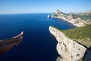 Cap de Formentor, Mirador Es Colomer. A young lady enjoys sitting at the brink.