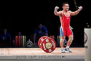 Nov 21, 2015; Houston, TX, USA; Yun Choi Om reacts after making a lift in the mens 56kg division at the International Weightlifting Federation World Championships at George R. Brown Convention Center. Mandatory Credit: Thomas B. Shea-USA TODAY Sports