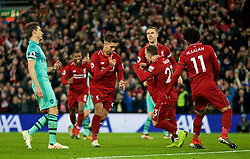 LIVERPOOL, ENGLAND - Saturday, December 29, 2018: Liverpool's Roberto Firmino celebrates scoring the fifth goal, with team-mates, completing his hat-trick, during the FA Premier League match between Liverpool FC and Arsenal FC at Anfield. (Pic by David Rawcliffe/Propaganda)