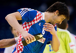 Marko Kopljar, best player of Croatia  celebrates after the handball match between Croatia and Spain for 3rd place game at 10th EHF European Handball Championship Serbia 2012, on January 29, 2012 in Beogradska Arena, Belgrade, Serbia.  Croatia defeated Spain 31-27 and won 3rd place. (Photo By Vid Ponikvar / Sportida.com)